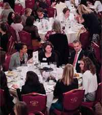 People sat down for lunch, networking at their tables