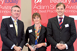 Treasury Today in China, Highly Commended – Photo of Richard Parkinson, Sandra Uddbäck from Atlas Copco accepting on behalf of Audrey Deng and Pontus Ljungh, Deutsche Bank.