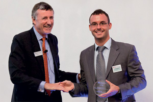 Outstanding Insourcing/Outsourcing, Winner – Richard Parkinson and Jose Luis Marti accepting on behalf of Microsoft.