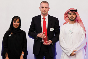 Effective Risk Management, Winner – Fatema Al Sayegh, Alastair Fiddes and Faisal Falaknaz accepting on behalf of the Treasury Team at Mubadala.