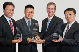 Treasury Today's Top Treasury Team, Winner – Nicholas Ro, Wei Shi, Jeff Carter and Jiming Chen collecting on behalf of Paul Boodee.