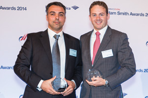 George Pittas of Ericsson collecting the Award on behalf of Ragnar Lodén and Mark Tweedie of Citi.