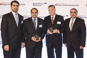 Rashed Al Qubaisi of Abu Dhabi Health Services Company collecting the Award on behalf of Bernhard Solleder and Howard Gaunt and Mohamed Al Ali of Abu Dhabi Commercial Bank.