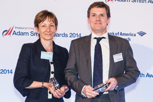 Jo Woods of Boston Consulting Group collecting the Award on behalf of Mark Salehar and David McGowan of BNP Paribas.